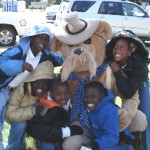 Local kids pose with the Teddy Roosevelt Bear